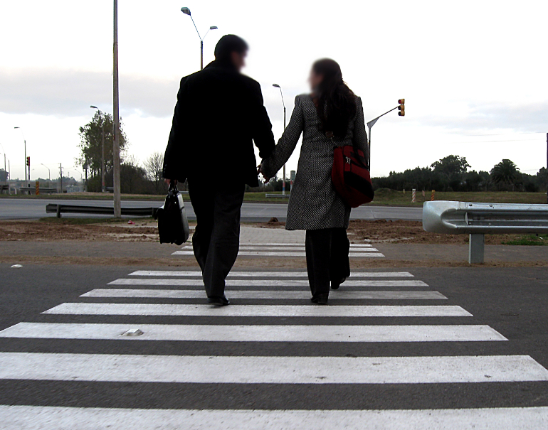Couple crossing the street holding hands